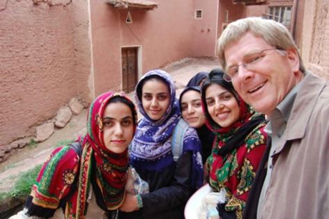 A picture of a German tourist alongside Iranian girls