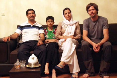 A European tourist alongside an Iranian family