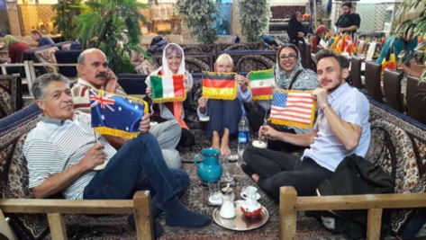 The presence of a number of tourists from different countries in one of the traditional Iranian restaurants